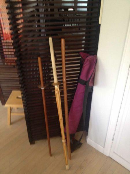 Three wooden practice swords